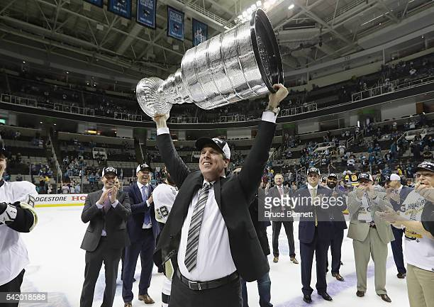 Head coach Mike Sullivan of the Pittsburgh Penguins celebrates with the Stanley Cup after their 31 victory to win the Stanley Cup against the San...