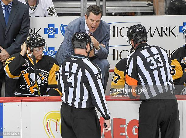 Head coach Mike Sullivan of the Pittsburgh Penguins gets an explanation from referee Kevin Pollock after a goal was waved off in second period during...