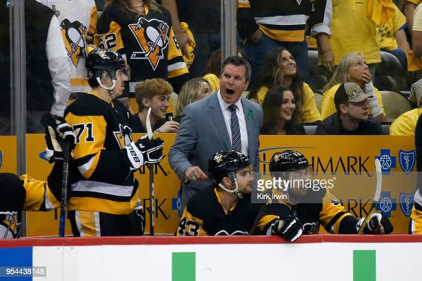 Head coach Mike Sullivan of the Pittsburgh Penguins gives instructions to his players in Game Three of the Eastern Conference Second Round during the...