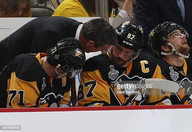 Head Coach Mike Sullivan of the Pittsburgh Penguins has a word with captain Sidney Crosby of the Pittsburgh Penguins at the bench during Game One of...