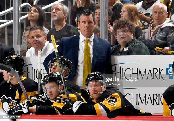 Head coach Mike Sullivan of the Pittsburgh Penguins looks on against the Washington Capitals at PPG Paints Arena on October 4 2018 in Pittsburgh...