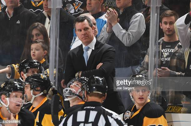 Head coach Mike Sullivan of the Pittsburgh Penguins looks on against the Winnipeg Jets at PPG Paints Arena on February 16 2017 in Pittsburgh...