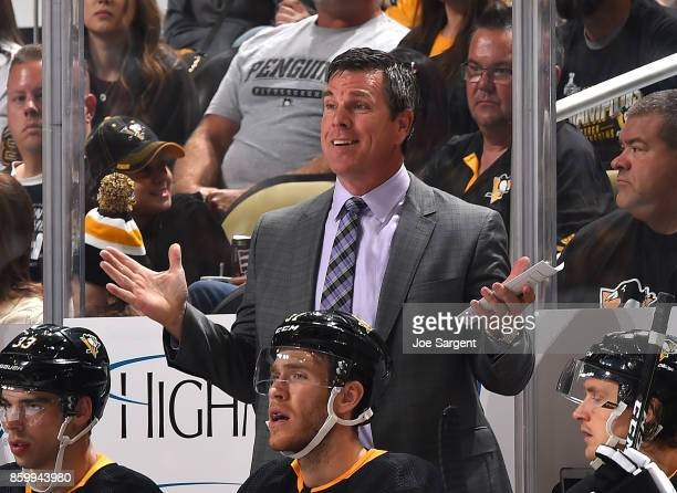 Head coach Mike Sullivan of the Pittsburgh Penguins looks on against the Nashville Predators at PPG Paints Arena on October 7 2017 in Pittsburgh...