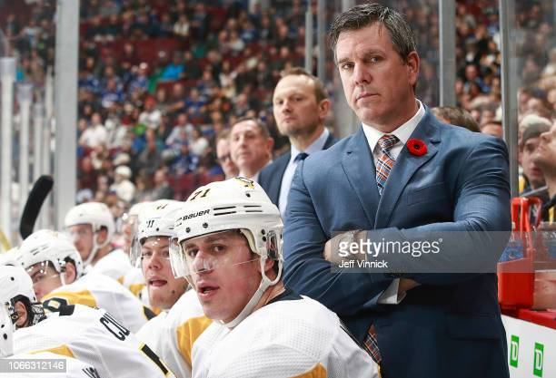 Head coach Mike Sullivan of the Pittsburgh Penguins looks on from the bench during their NHL game against the Vancouver Canucks at Rogers Arena...
