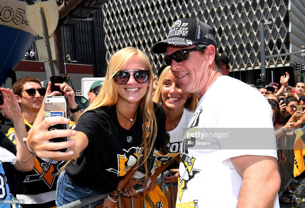 Head coach Mike Sullivan of the Pittsburgh Penguins takes photos with fans during the Pittsburgh Penguins Victory Parade And Rally on June 14, 2017 in Pittsburgh, Pennsylvania.