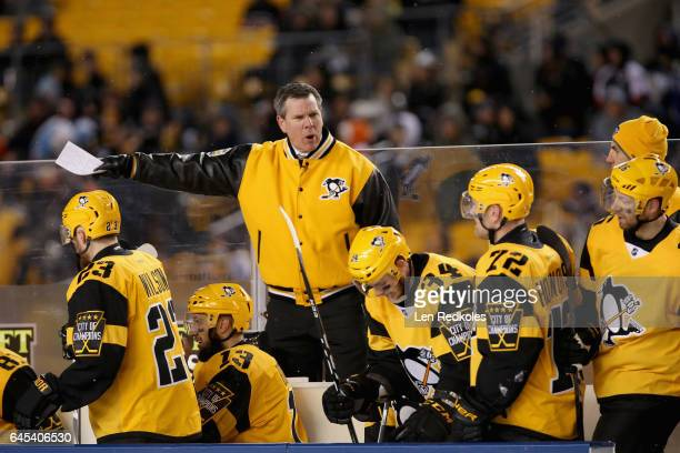 Head Coach Mike Sullivan of the Pittsburgh Penguins talks to his players on the bench during the second period of the 2017 Coors Light NHL Stadium...
