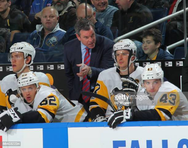 Head coach Mike Sullivan of the Pittsburgh Penguins talks to Sidney Crosby during an NHL game against the Buffalo Sabres on December 1 2017 at...