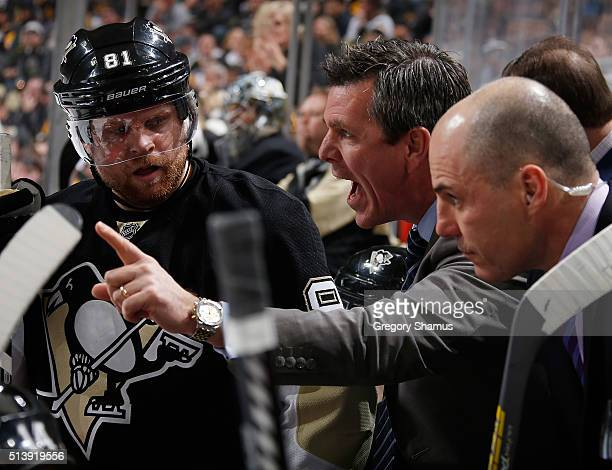 Head Coach Mike Sullivan of the Pittsburgh Penguins talks with his team during the third period against the Calgary Flames at Consol Energy Center on...