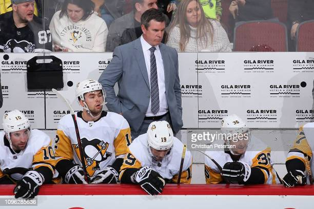 Head coach Mike Sullivan of the Pittsburgh Penguins watches from the bench during the first period of the NHL game against the Arizona Coyotes at...