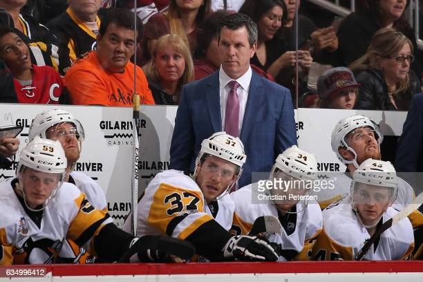 Head coach Mike Sullivan of the Pittsburgh Penguins watches from the bench during the third period of the NHL game against the Arizona Coyotes at...