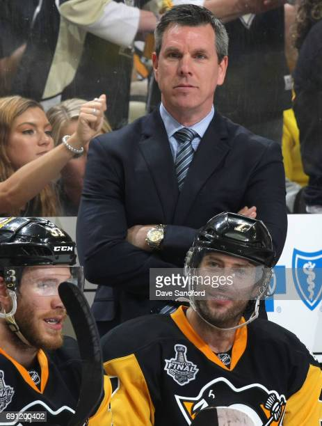 Head coach Mike Sullivan of the Pittsburgh Penguins watches his team play in the third period of Game Two of the 2017 NHL Stanley Cup Final against...