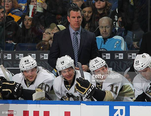 Head coach Mike Sullivan of the Pittsburgh Penguins watches the action against the Buffalo Sabres in an NHL game on February 21 2016 at the First...