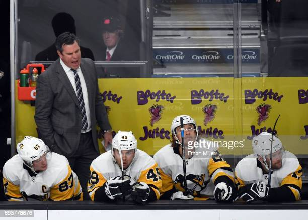 Head coach Mike Sullivan of the Pittsburgh Penguins yells on the bench behind Sidney Crosby Dominik Simon Carl Hagelin and Bryan Rust in the second...