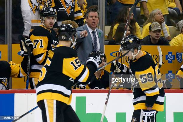 Head coach Mike Sullivan of the Pittsburgh Penguins yells out instructions to Riley Sheahan of the Pittsburgh Penguins during the second period in...
