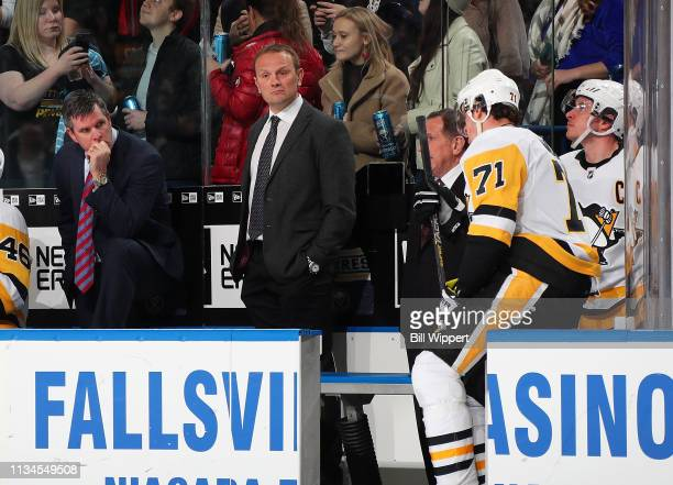 Head coach Mike Sullvan and assistant coach Sergei Gonchar of the Pittsburgh Penguins look at Evgeni Malkin and Sidney Crosby after an NHL game...