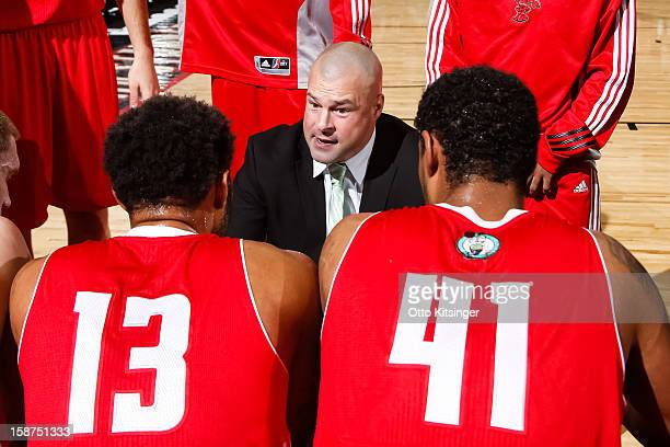 Head Coach Mike Taylor of the Maine Red Claws talks to his team during a time out in the NBA DLeague game against the Idaho Stampede on December 26...