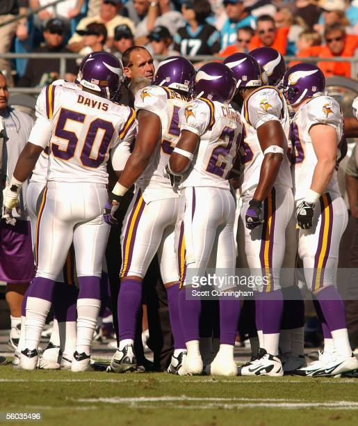 Head Coach Mike Tice of the Minnesota Vikings speaks with his team during a timeout against the Carolina Panthers on October 30 2005 at Bank Of...