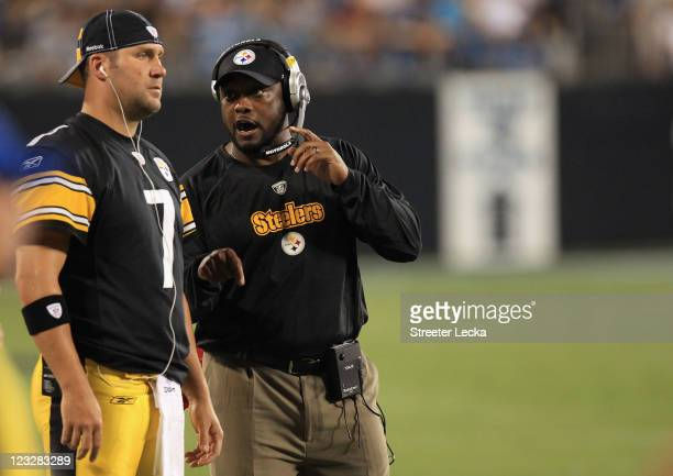 Head coach Mike Tomlin and Ben Roethlisberger of the Pittsburgh Steelers talk on the sidelines during their preseason game against the Carolina...
