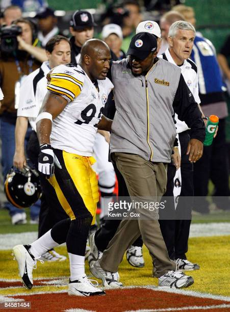 Head coach Mike Tomlin and James Harrison of the Pittsburgh Steelers talk on the field after Harrison scored on a 100-yard interception return in the...