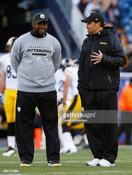 Head coach Mike Tomlin and offensive coordinator Todd Haley of the Pittsburgh Steelers talk prior to the game against the New England Patriots at...
