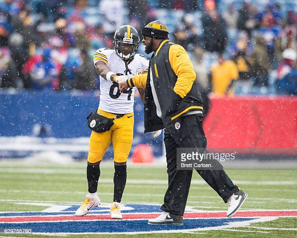 Head coach Mike Tomlin fist bumps with Antonio Brown of the Pittsburgh Steelers before the game against the Buffalo Bills on December 11 2016 at New...