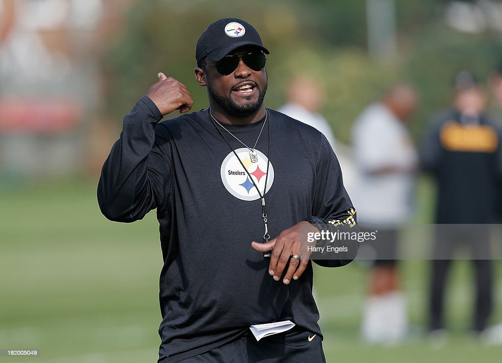 Head Coach Mike Tomlin in action during a Pittsburgh Steelers training session at the Twyford Avenue Sports Ground on September 27, 2013 in London, England.