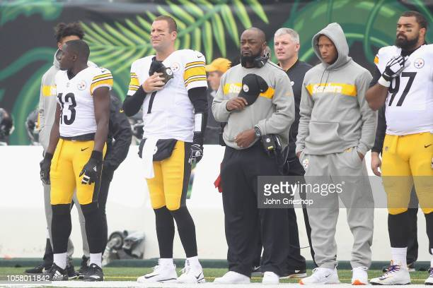 Head Coach Mike Tomlin of the Pittsburgh Steelers and Ben Roethlisberger Ryan Shazier and Cameron Heyward stand for the National Anthem before their...