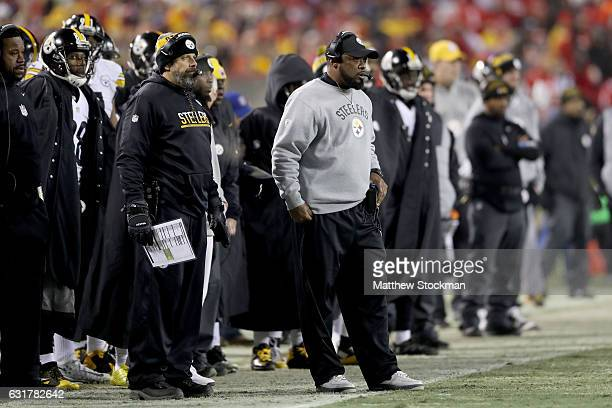 Head coach Mike Tomlin of the Pittsburgh Steelers and former Kansas City Chiefs head coach and current offensive coordinator Todd Haley watch a play...