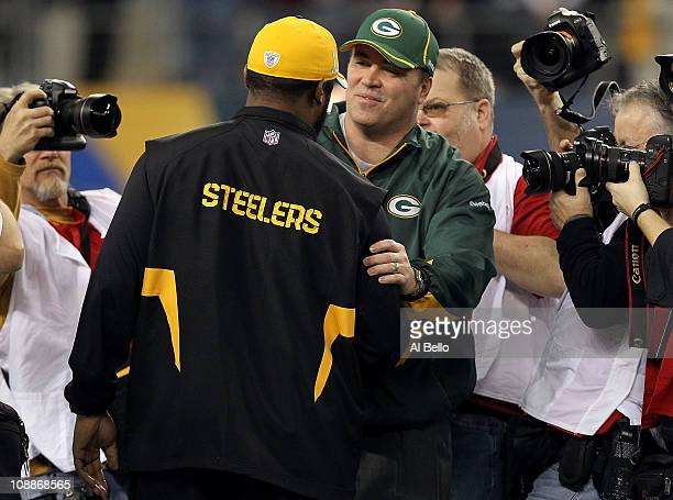 Head coach Mike Tomlin of the Pittsburgh Steelers and head coach Mike McCarthy of the Green Bay Packers speak before Super Bowl XLV at Cowboys...