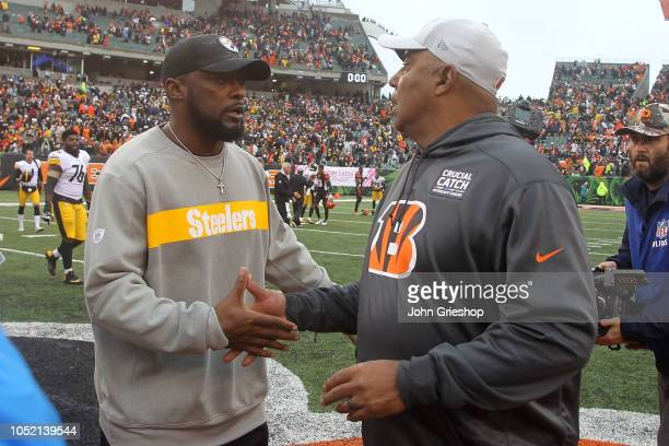 Head coach Mike Tomlin of the Pittsburgh Steelers and head coach Marvin Lewis of the Cincinnati Bengals shake hands at the end of the game at Paul...