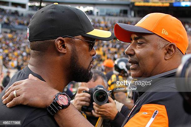 Head Coach Mike Tomlin of the Pittsburgh Steelers and Head Coach Marvin Lewis of the Cincinnati Bengals talk at the end of the game at Heinz Field on...