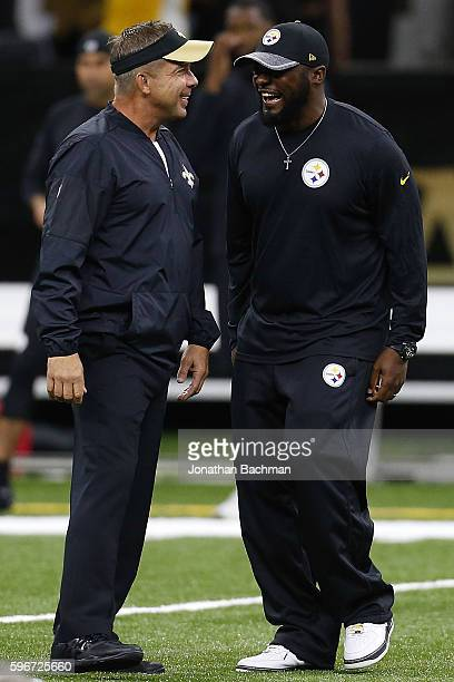 Head coach Mike Tomlin of the Pittsburgh Steelers and head coach Sean Payton of the New Orleans Saints talk before a game at the MercedesBenz...