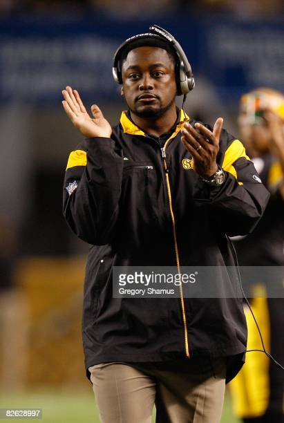 Head Coach Mike Tomlin of the Pittsburgh Steelers applauds his team during a preseason NFL game against the Carolina Panthers on August 28, 2008 at...