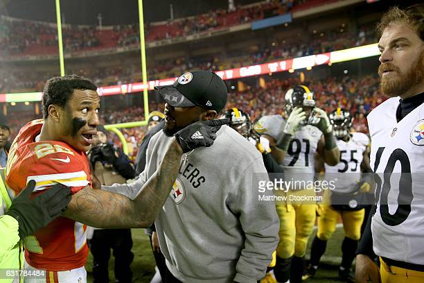 Head coach Mike Tomlin of the Pittsburgh Steelers attempts to calm down cornerback Marcus Peters of the Kansas City Chiefs in the AFC Divisional...