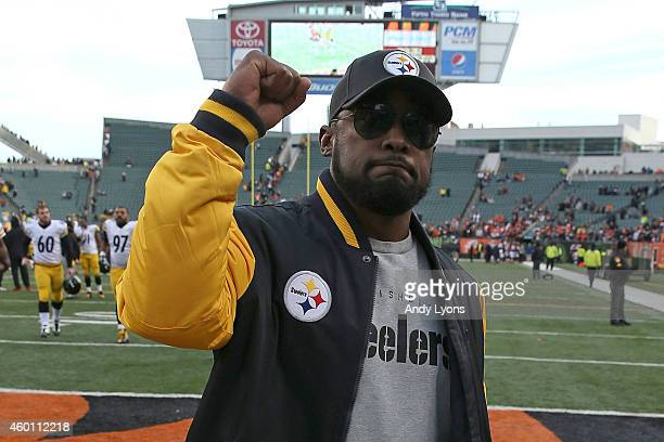 Head Coach Mike Tomlin of the Pittsburgh Steelers celebrates after defeating the Cincinnati Bengals 4221 at Paul Brown Stadium on December 7 2014 in...