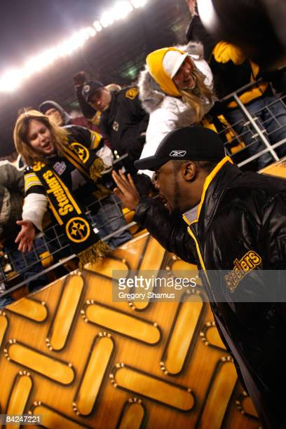 Head coach Mike Tomlin of the Pittsburgh Steelers celebrates with fans after their 3524 win against the San Diego Chargers during their AFC...