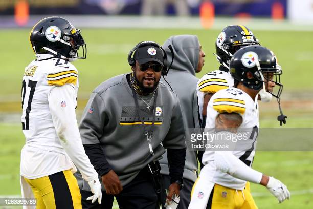 Head coach Mike Tomlin of the Pittsburgh Steelers celebrates with the defense after stopping the Baltimore Ravens on fourth down late in the fourth...