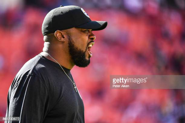 Head coach Mike Tomlin of the Pittsburgh Steelers cheers on players during warm ups prior to the game against the Kansas City Chiefs at Arrowhead...