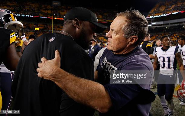 Head Coach Mike Tomlin of the Pittsburgh Steelers embraces Head Coach Bill Belichick of the New England Patriots after the conclusion of the New...
