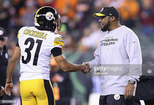 Head coach Mike Tomlin of the Pittsburgh Steelers greets Ross Cockrell prior to the AFC Wild Card Playoff game against the Cincinnati Bengals at Paul...