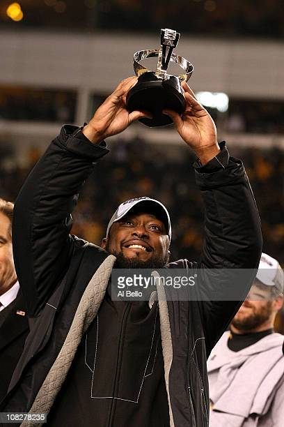 Head coach Mike Tomlin of the Pittsburgh Steelers holds up the Lamar Hunt trophy after the Steelers defeated the New York Jets 24 to 19 in the 2011...
