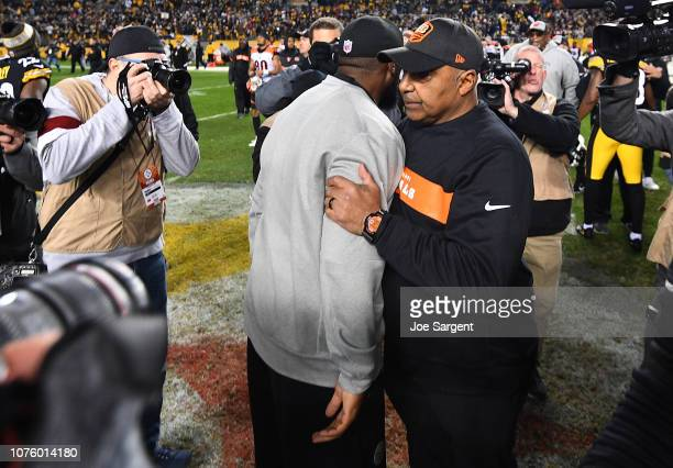 head coach Mike Tomlin of the Pittsburgh Steelers hugs head coach Marvin Lewis of the Cincinnati Bengals after the Steelers 1613 win over the Bengals...