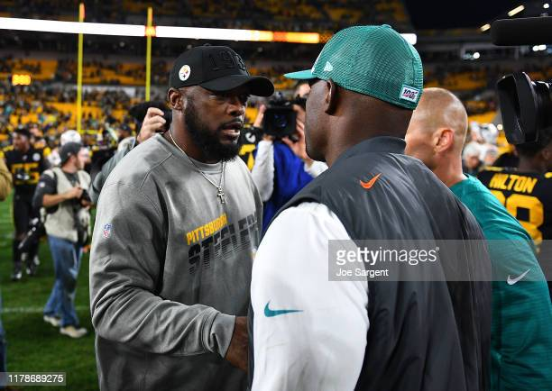 Head coach Mike Tomlin of the Pittsburgh Steelers is congratulated by head coach Brian Flores of the Miami Dolphins after Pittsburgh's 27-14 win at...