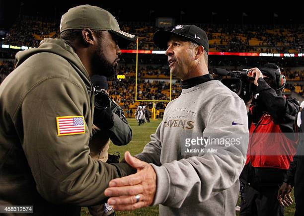 Head coach Mike Tomlin of the Pittsburgh Steelers is congratulated by head coach John Harbaugh of the Baltimore Ravens after Pittsburgh's 4323 win at...