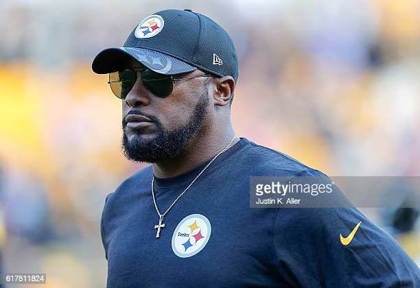 Head Coach Mike Tomlin of the Pittsburgh Steelers looks on during warmups before the game against the New England Patriots at Heinz Field on October...