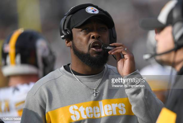 Head coach Mike Tomlin of the Pittsburgh Steelers looks on from the sidelines against the Oakland Raiders during an NFL football game at...