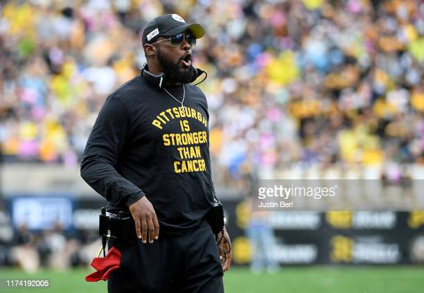 Head coach Mike Tomlin of the Pittsburgh Steelers looks on from the sidelines in the second half during the game against the Baltimore Ravens at...