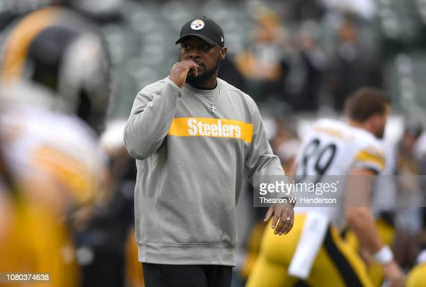 Head coach Mike Tomlin of the Pittsburgh Steelers looks on while his team warms up prior to the start of an NFL football game against the Oakland...