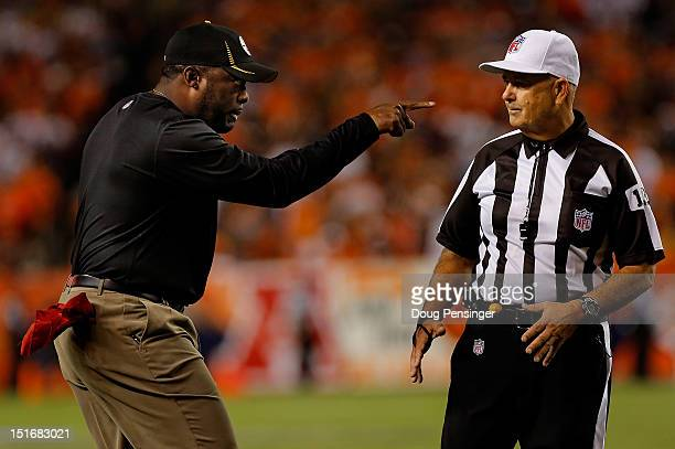 Head coach Mike Tomlin of the Pittsburgh Steelers protests a call with umpire Gerald Wright on a pass reception by wide receiver Eric Decker of the...