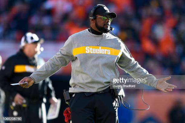 Head coach Mike Tomlin of the Pittsburgh Steelers reacts after the offense failed to convert on third down in the first quarter of a game at Broncos...